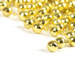 Background made of a brilliant celebratory beads of golden color - Stock Photo