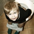 Little boy on the toilet - Stock Photo