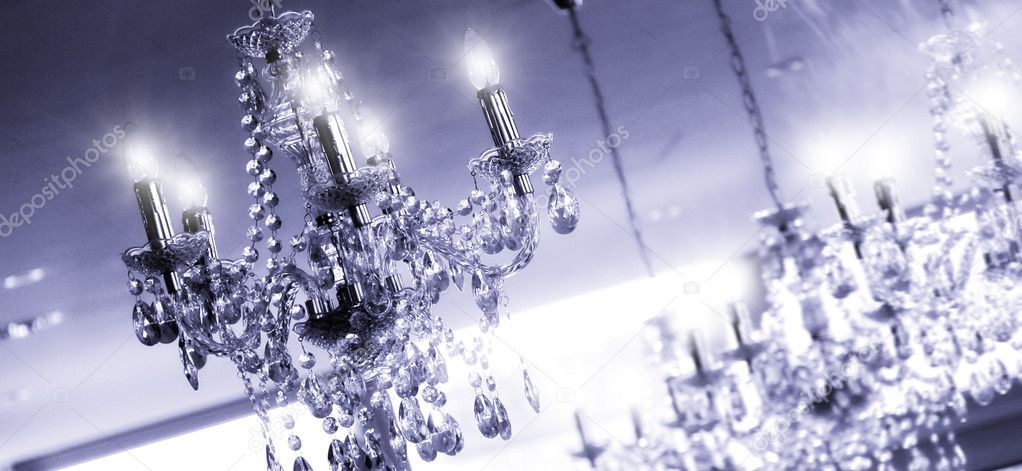 Any chandeliers on the ceiling of a luxury room — Stock Photo #9860619