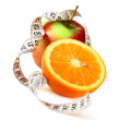 Orange half apple and measure tape - Stock Photo