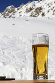 Glass of beer in mountain cafe — Stock Photo
