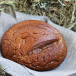 Stock Photo: Brown bread on hay