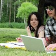 Couple studying outdoors — Stock Photo