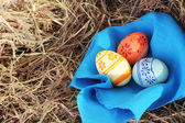 Easter eggs and textile on hay — Stock Photo