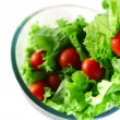 Light lettuce and tomatoes flying salad concept — Stock Photo