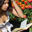 Stock Photo: Reading young woman
