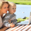 Mother and child with laptop — Stock Photo