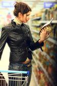 Young woman choosing food — Stock Photo