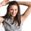 Teen putting up her hair - Stockfoto