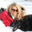 Woman playing with dog in winter — Stock Photo #9244344