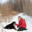 Woman with dog in snow — Stock Photo #9245907