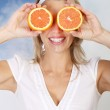 Woman with grapefruits — Stock Photo #9258168