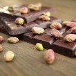 Chocolate and pistachios — Stock Photo