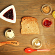 Toast and jam on table - Stock Photo