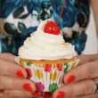 Offering a cupcake — Stock Photo