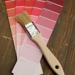 Brush on a red color palette - Foto Stock