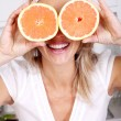Woman with grapefruits — Stock Photo
