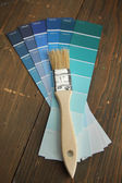 Brush on a blue color palette — Stock Photo