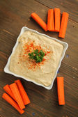 Hummus with carrots — Stock Photo