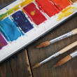 Water painting and brushes - Stock Photo