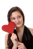 Teenager girl holding a heart — Photo