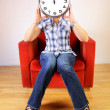 Woman holding a clock - Stock Photo