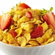 Bowl of cornflakes and strawberries on white background — Stock Photo