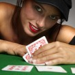 Woman playing poker at a table — Stock Photo