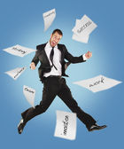 Success business man jumping with work papers — Stock Photo