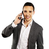 Young businessman talking on the cellphone, isolated — Stock Photo