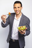 Young business man with salad — Stock Photo