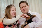Child with father playing with dog — Stock Photo
