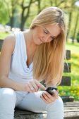 Mobile communication - smiling teenager — Stock Photo
