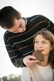 Man gives chocolate to woman — Photo
