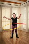 Girl dancing with rings — Stock Photo