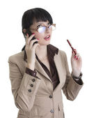 Business woman talking over cell phone — Stock Photo