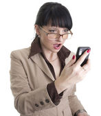 Frustrated business woman with cell phone — Stock Photo