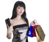 Glamorous woman with shopping bags and wallet — Stock Photo