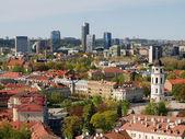 Vilnius old city red roofs and skyscrapers — Stock Photo