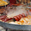 Stock Photo: Cooking food - grilled mutton, sausages with vegetables