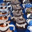 earthenware products collection - different colors steins and stew pots — Stock Photo