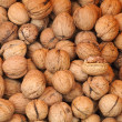 Foto Stock: Background with food - walnuts to be cracked