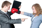 Businesswoman fighting off the boss — Stock Photo