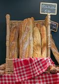 Bread and basketful to bread from the baker — Stock Photo
