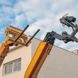 Stock Photo: Lift trucks, on blue sky