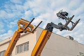 Lift trucks, on blue sky — Stok fotoğraf