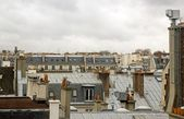 Chimneys in the roofs of Paris — Stockfoto
