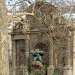 Stock Photo: Medici fountain through trees, statue of Polyphemus