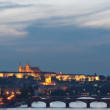 Prague Castle and bridges at sunset - Stock Photo