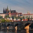 Closer view to Charles Bridge and Prague Castle - Stock Photo